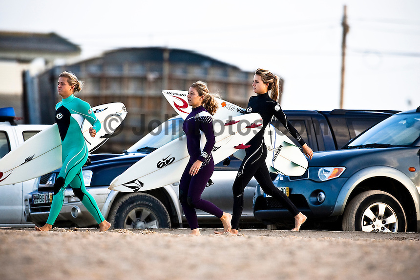 PAULINE ADO (FRA), COCO HO (HAW) and ALANA BLANCHARD (HAW)  Peniche, Portugal (Thursday, October 22, 2009) - Organisers of the Rip Curl Pro Search were able to get Round 1 of the contest under way today at a surf spot called the Wedge. Yesterday's huge storm surf had subsided overnight allowing nine heats of Round 1 to be completed in 2 meter waves. Wildcard OWEN WRIGHT (AUS)  was one of the standout performers of the day while Portugals TIAGO PIRES was elimaneted from the event by NATHANIEL CURRAN (USA)...The Rip Curl Pro Search which will culminate the European leg of the 2009 ASP Men's World Tour in the wave abundant Portuguese region of Peniche was called off again today due strong onshore winds, driving rain and rough surf. The contest is hosting the world's best surfers from October 19 - 30, 2009 and will run when conditions are favorable...Event No. 9 of 10 on the 2009 ASP World Tour, the Rip Curl Pro Search is poised to deliver high drama with projected sizable swells setting the scene for a possible ASP World Title showdown and several requalification campaigns...Mick Fanning (AUS), 28, former ASP World Champion (2007) and current ASP World No. 1, has been on a rampage during the back half of the season, claiming back-to-back wins in California and France before taking the ASP ratings' lead last week in Spain. If Fanning finishes higher than 3rd at the Rip Curl Pro Search in Portugal, the Australian could claim the 2009 ASP World Title in Europe, contingent upon the finishes of other frontrunners...Photo: Joliphotos.com