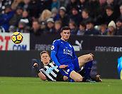 9th December 2017, St James Park, Newcastle upon Tyne, England; EPL Premier League football, Newcastle United versus Leicester City; Matt Ritchie of Newcastle United and Ben Chilwell of Leicester City slide in for a challenge