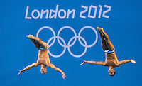 30 JUL 2012 - LONDON, GBR - Peter Waterfield (GBR) (left) and Tom Daley (GBR) (right) of Great Britain diving during the Mens 10m Synchronised Diving at the London 2012 Olympic Games event in the Aquatics Centre in the Olympic Park, Stratford, London, Great Britain .(PHOTO (C) 2012 NIGEL FARROW)