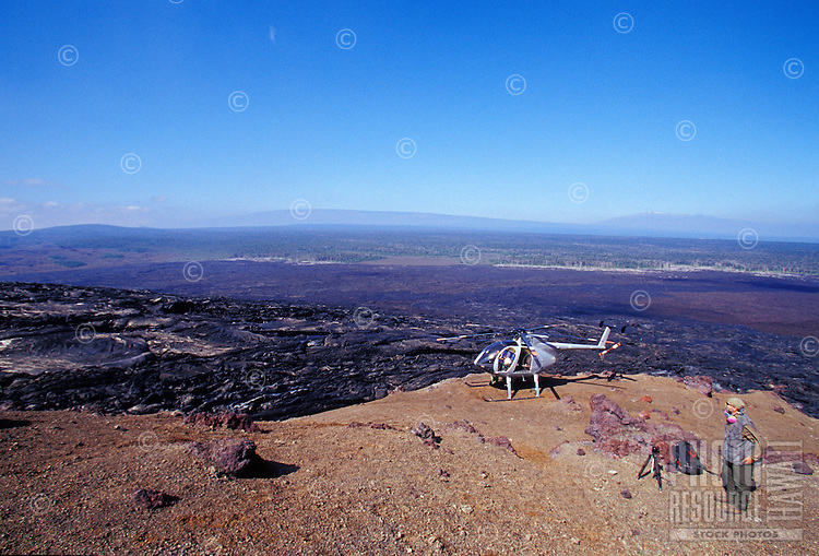 Vetran volcano photographer Brad Lewis at helicopter while filming the eruption at Pu' O'o crater, Volcanoes National Park