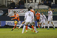 Alex Gilliead of Luton Town (left) scores his team's third goal of the game to make the score 3-1 during the Sky Bet League 2 match between Luton Town and Barnet at Kenilworth Road, Luton, England on 31 December 2016. Photo by David Horn.