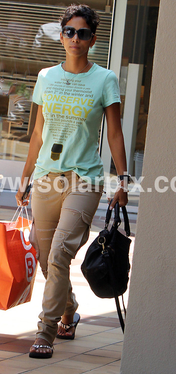**ALL ROUND PICTURES FROM SOLARPIX.COM**.**SYNDICATION RIGHTS FOR UK, AUSTRALIA, DENMARK, PORTUGAL, S. AFRICA, SPAIN & DUBAI (U.A.E) & ASIA (EXCLUDING JAPAN) ONLY**.Halle Berry Shops at CB2 in Hollywood, CA, USA, 23 June 2010.This pic: Halle Berry.JOB REF: 11538    PHZ candid   DATE: 23_06_2010.**MUST CREDIT SOLARPIX.COM OR DOUBLE FEE WILL BE CHARGED**.**MUST NOTIFY SOLARPIX OF ONLINE USAGE**.**CALL US ON: +34 952 811 768 or LOW RATE FROM UK 0844 617 7637**
