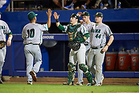 Siena Saints catcher Phil Madonna (3) and Nico Ramos (44) high five Yasser Santana (10) in between innings during a game against the Florida Gators on February 16, 2018 at Alfred A. McKethan Stadium in Gainesville, Florida.  Florida defeated Siena 7-1.  (Mike Janes/Four Seam Images)