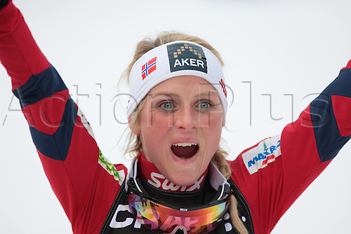 09.01.2011.  TOUR DE SKI - STAGE 8 - FINAL CLIMB. JOHAUG Therese celebrates at the finish of the final climb of Cermis in Val Di Fiemme, Italy.