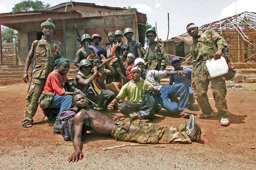 BOY SOLDIERS FROM JOHNNY KOROMA'S &quot;WESTSIDE BOYS&quot;, NOW A MILITIA AUGMENTED INTO THE SLA, AFTER TAKING MASIAKA FROM THE RUF.<br /> <br /> 15 MAY 2000 SIERRA LEONE