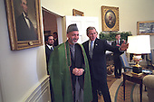 United States President George W. Bush welcomes the Chairman of the Afghan Interim Authority Hamid Karzai to the Oval Office, Monday, January 28, 2002..Mandatory Credit: Eric Draper - White House via CNP.