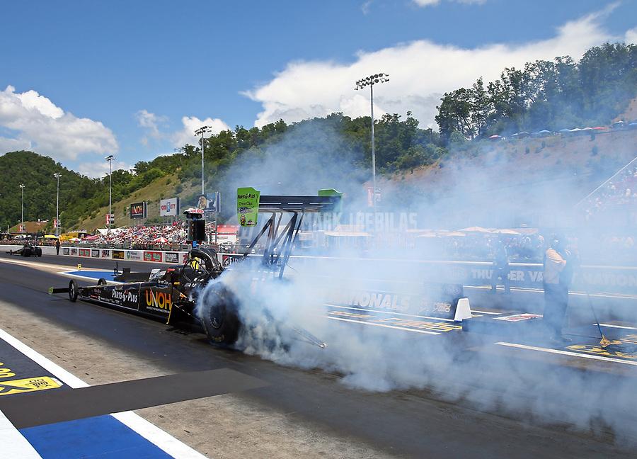 Jun 18, 2017; Bristol, TN, USA; NHRA top fuel driver Clay Millican during the Thunder Valley Nationals at Bristol Dragway. Mandatory Credit: Mark J. Rebilas-USA TODAY Sports