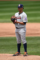 Binghamton Mets starting pitcher Hansel Robles (45) gets ready to deliver a pitch during a game against the Erie Seawolves on July 13, 2014 at Jerry Uht Park in Erie, Pennsylvania.  Binghamton defeated Erie 5-4.  (Mike Janes/Four Seam Images)