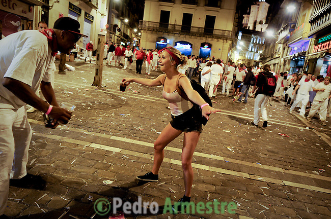 Two young dancers during the San Fermin Festival, on July 09, 2012, in Pamplona, northern Spain. The festival is a symbol of Spanish culture that attracts thousands of tourists to watch the bull runs despite heavy condemnation from animal rights groups . (c) Pedro ARMESTRE