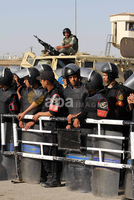 Egyptian riot police stand in front of the courthouse where ex-President Hosni Mubarak received a verdict in his trial for charges related to the death of protesters in Cairo, Egypt, Saturday, May 2, 2012. Egypt's ex-President Hosni Mubarak was sentenced to life in prison Saturday for his role in the killing of protesters during last year's revolution that forced him from power, a verdict that caps a stunning fall from grace for a man who ruled the country as his personal fiefdom for nearly three decades. Photo by Ashraf Amra