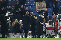 A Chelsea fan holds aloft a sign asking for Mason Mount's shirt during Chelsea vs Aston Villa, Premier League Football at Stamford Bridge on 4th December 2019