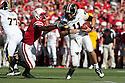 30 October 2010: Nebraska linebacker Lavonte David (4) sacks Missouri quarterback Blaine Gabbert (11) in the first quarter at Memorial Stadium in Lincoln, Nebraska. Nebraska defeated Missouri 31 to 17.