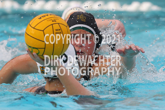 Manhattan Beach, CA 02/16/11 - Natalie Lavinsky (Mira Costa #3) and Haley Kunert (C)  (Edison #5) in action during the 2011 first round CIF girls waterpolo playoffs between Edison and Mira Costa.