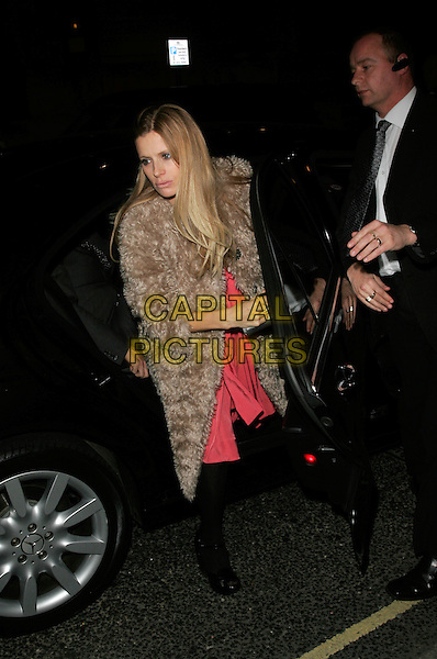 LAURA BAILEY.The Vogue Pre BAFTA Party at Cecconis, Mayfair, London, England..February 8th, 2008 .full length brown fur beige pink dress black tights car.CAP/AH.©Adam Houghton/Capital Pictures