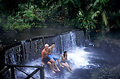 Tabacon, Costa Rica. Hot volcanic springs with mist hanging in the air; La Ceiba waterfall.