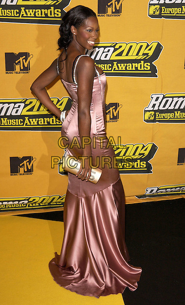 JAMELIA.MTV Europe Music Awards 2004,.Tor di Valle, Rome, Italy, 18th November 2004..full length pink satin dress diamante straps clutch bag.Ref: DH.www.capitalpictures.com.sales@capitalpictures.com.©David Hitchens/Capital Pictures .