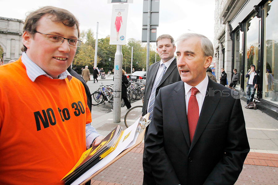 NO REPRO FEE. 26/10/2011.VOTE NO TO THE 30TH AMENDMENT to the Constitution.  Presidential candidate Gay Mitchell is pictured with no campaigner Stephen Ohare from Irish Council for Civil Liberties outside St Stephens Green.With 24 hours to polling No Campaign volunteers  joined the 'Roos at St Stephen's Green Shopping Centre to canvass shoppers and highlight the dangers of the 30th amendment to the Constitution.For further information, and to arrange interviews, see the note below, and/or contact:Stephen O'HarePolicy & Research Officer, Irish Council for Civil Liberties. Tel 085 711 26 35 the campaign website www.kangaroocourts.net. Picture James Horan/Collins