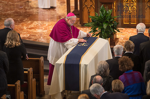 Mar. 4, 2015; Bishop Daniel Jenky, C.S.C., Bishop of Peoria, IL, places a crucifix on the casket of Notre Dame President Emeritus Rev. Theodore M. Hesburgh, C.S.C. during the funeral Mass at the Basilica of the Sacred Heart. (Photo by Matt Cashore/University of Notre Dame)