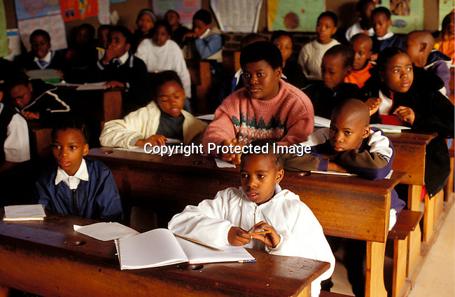 dieduca00145 Education, School, Classroom: Unidentified children during a math class on July 12, 2002 at a Catholic school in Soweto, a black township outside Johannesburg, South Africa. Soweto is the largest township in the country and itÕs estimated that about 3-4 million people resides there..©Per-Anders Pettersson /iAfrika Photos...