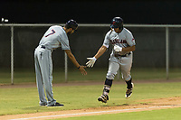 AZL Indians 2 catcher Noah Naylor (12) is congratulated by manager Jerry Owens (7) after hitting his first professional home run during an Arizona League game against the AZL Cubs 2 at Sloan Park on August 2, 2018 in Mesa, Arizona. The AZL Indians 2 defeated the AZL Cubs 2 by a score of 9-8. (Zachary Lucy/Four Seam Images)