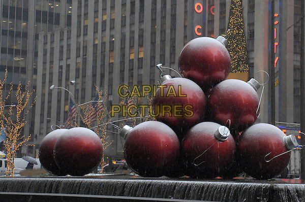 SNOW FALLING .Christmas decorations in front of the Time Life building on Sixth Avenue as snow falls late Thursday morning in New York City, New York, USA,.12 December 2007..giant christmas baubles snowing.CAP/ADM/BL.©Bill Lyons/AdMedia/Capital Pictures. *** Local Caption ***