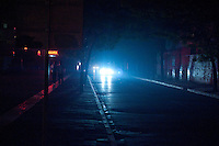 Evening landscape view of car headlights shining on a street in the Xī'ān Shì Weiyang District in Shaanxi Province.  © LAN
