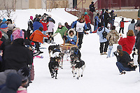 Saturday March 6 , 2010   Sonny Lindner and team make their way through the specators along the trail near Tudor Road during the ceremonial start of the 2010 Iditarod in Anchorage , Alaska