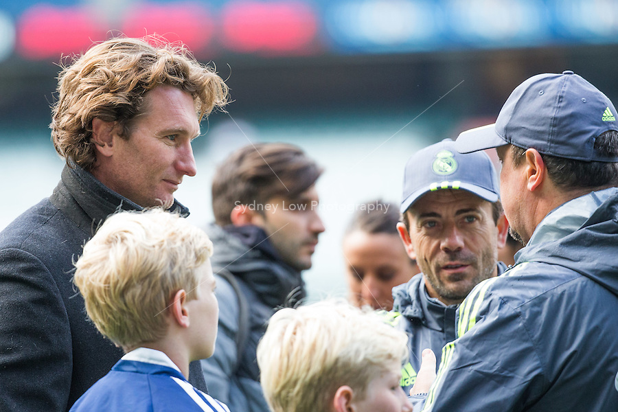 Melbourne, 17 July 2015 - Essendon Football Club head coach James Hird (L) talks with Real Madrid Manager Rafa Benitez after his team's training session at the Melbourne Cricket Ground ahead of their International Champions Cup match against AS Roma tomorrow in Melbourne, Australia. Photo Sydney Low/AsteriskImages.com