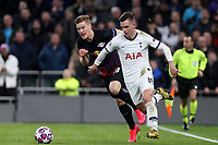 Giovani Lo Celso of Tottenham Hotspur and Marcel Halstenberg of RB Leipzig  during Tottenham Hotspur vs RB Leipzig, UEFA Champions League Football at Tottenham Hotspur Stadium on 19th February 2020
