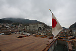 Onagawa, Japan - A photo made available on April 11 shows a flag of Japan hoisted in an area damaged by the devastating March 11 earthquake and tsunami that rocked the northern part of Japan. (Photo by Christopher Jue/AFLO) [2331] **ITALY OUT**