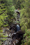 Falls of Bruar with hiker on bridge, near Blair Atholl, Perth and Kinross, Scotland, UK