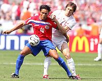 Walter Centeno (10) of Costa Rica holds off Jacek Krzynowski (8) of Poland. Poland defeated Costa Rica 2-1 in their FIFA World Cup Group A match at FIFA World Cup Stadium, Hanover, Germany, June 20, 2006.