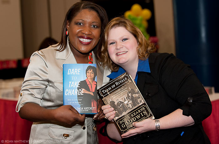 Sonta Henderson and Sarah Schimmer  wait to get their books signed at the Eleventh Annual Texas Conference for Women