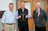 Janelle Jessen/Herald-Leader<br /> School board president Brian Lamb, left, and Superintendent Ken Ramey, right, presented Roger Holroyd, center, with a plaque on Thursday honoring him for his service to the Siloam Springs School Board. Holroyd formally announced his resignation from the board during Thursday's meeting after nearly 10 years on the board.