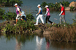 HAIKOU, CHINA - OCTOBER 30:  Se Ri Pak (2nd L), He Yong Choi (2nd R) and Sung Ki Ahn (R)  of South Korea walk on the 18th tee during day four of the Mission Hills Start Trophy tournament at Mission Hills Resort on October 30, 2010 in Haikou, China. The Mission Hills Star Trophy is Asia's leading leisure liflestyle event and features Hollywood celebrities and international golf stars.  Photo by Victor Fraile / The Power of Sport Images