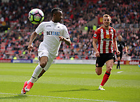 (L-R) Jordan Ayew of Swansea City closely followed by Seb Larsson of Sunderland during the Premier League match between Sunderland and Swansea City at the Stadium of Light, Sunderland, England, UK. Saturday 13 May 2017