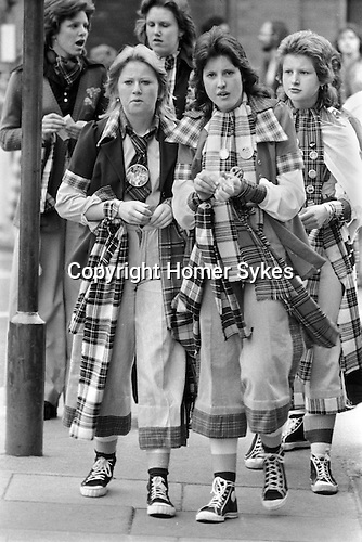 Bay City Rollers teen girls fans, wearing the fashionable tartan uniform made popular by the Bay City Rollers, short trousers and converses (trainers, sneakers, baseball boots)   Newcastle UK 1970s