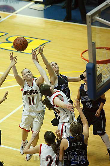 Taylorsville - Weber's Katie Wahlen (11) reaches for the rebound, Bingham's Megan Herrick (25) at right and Weber's Shay Sorensen (25) at bottom. Bingham vs. Weber High School girls basketball, 5A State Championship tournament Thursday February 26, 2009 at Salt Lake Community College..