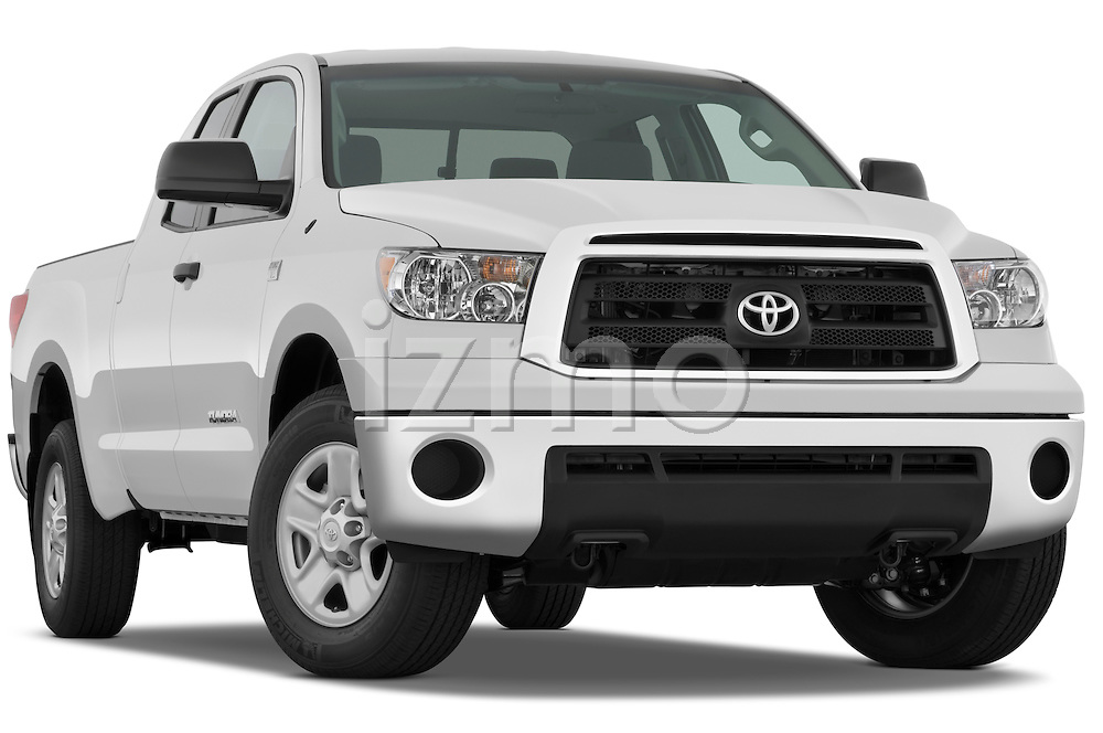 Low aggressive passenger side front three quarter view of a 2010 Toyota Tundra Double Cab 2WD.