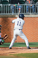 Christian Dicks (11) of the Florida Atlantic Owls at bat against the Charlotte 49ers at Hayes Stadium on March 14, 2015 in Charlotte, North Carolina.  The Owls defeated the 49ers 8-3 in game one of a double header.  (Brian Westerholt/Four Seam Images)