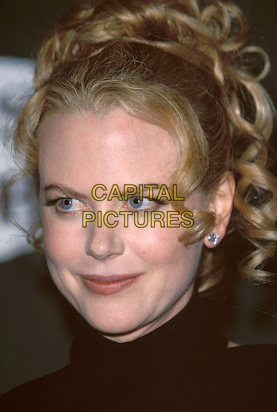 NICOLE KIDMAN..Awards of the London Film Critics Circle at The Dorchester.  ..Ref: 11455..portrait headshot, ringlets, curls, earrings..sales@capitalpictures.com..www.capitalpictures.com..