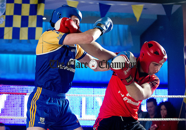 Patrick Kelly in action against Caimin Morey at the Clare Hurlers Fight Night in the Queens hotel, aid of The Clare Senior Hurlers Fund. Photograph by John Kelly.