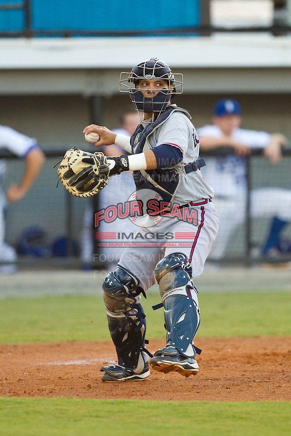 Danville Braves catcher Bryan De La Rosa (26) makes a throw to first base against the Burlington Royals at Burlington Athletic Park on August 16, 2013 in Burlington, North Carolina.  The Royals defeated the Braves 1-0.  (Brian Westerholt/Four Seam Images)