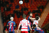 Nathaniel Knight Percival of Bradford City beats John Marquis of Doncaster Rovers in the air during the Sky Bet League 1 match between Doncaster Rovers and Bradford City at the Keepmoat Stadium, Doncaster, England on 19 March 2018. Photo by Thomas Gadd.