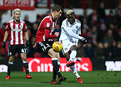 2nd December 2017, Griffen Park, Brentford, London; EFL Championship football, Brentford versus Fulham; Sheyi Ojo of Fulham taking a shot for attempted goal passed Andreas Bjelland of Brentford