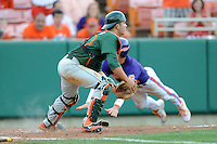 Catcher Garrett Kennedy #40 fields the throw as Steve Wilkerson slides in to score during a  game against the Clemson Tigers at Doug Kingsmore Stadium on March 31, 2012 in Clemson, South Carolina. The Tigers won the game 3-1. (Tony Farlow/Four Seam Images)..