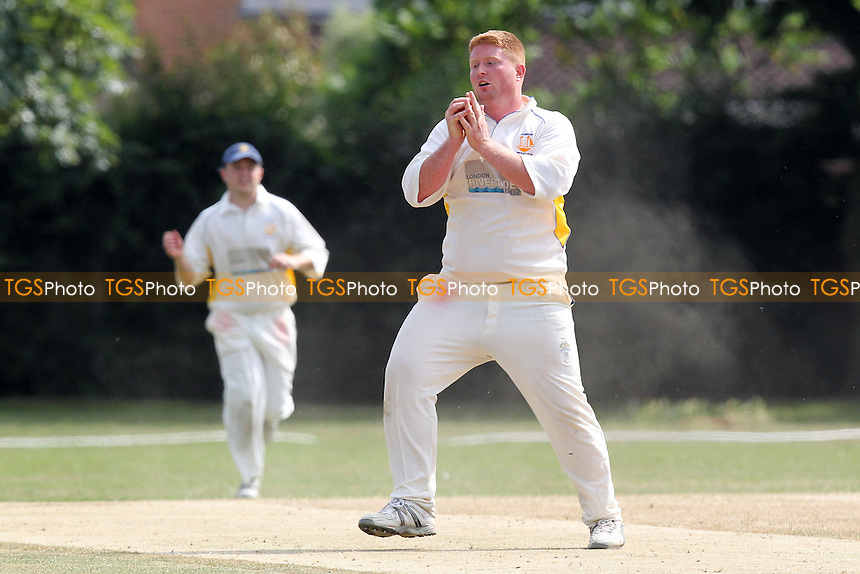 J Fuller takes a catch off his own bowling to dismiss Hornchurch Athletic batsman P Humphries and celebrates - Hornchurch Athletic CC vs Rainham CC - Mid-Essex Cricket League at Hylands Park - 13/07/13 - MANDATORY CREDIT: Gavin Ellis/TGSPHOTO - Self billing applies where appropriate - 0845 094 6026 - contact@tgsphoto.co.uk - NO UNPAID USE