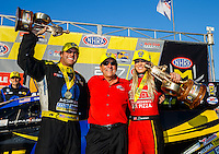 Feb 12, 2017; Pomona, CA, USA; NHRA top fuel driver Leah Pritchett (right) celebrates with team owner Don Schumacher (center) and funny car driver Matt Hagan after winning the Winternationals at Auto Club Raceway at Pomona. Mandatory Credit: Mark J. Rebilas-USA TODAY Sports
