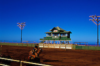 The Paniolo Rodeo Arena with a man riding a horse on Molokai Ranch