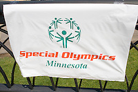 Banner and symbol on fence. Special Olympics U of M Bierman Athletic Complex. Minneapolis Minnesota USA